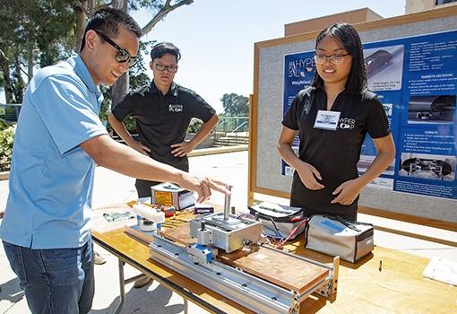 Hyperloop team members demonstrate their technology.
