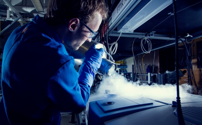 A graduate student works in the lab of John Bowers at UCSB's Institute for Energy Efficiency. Photo Credit: Matt Perko